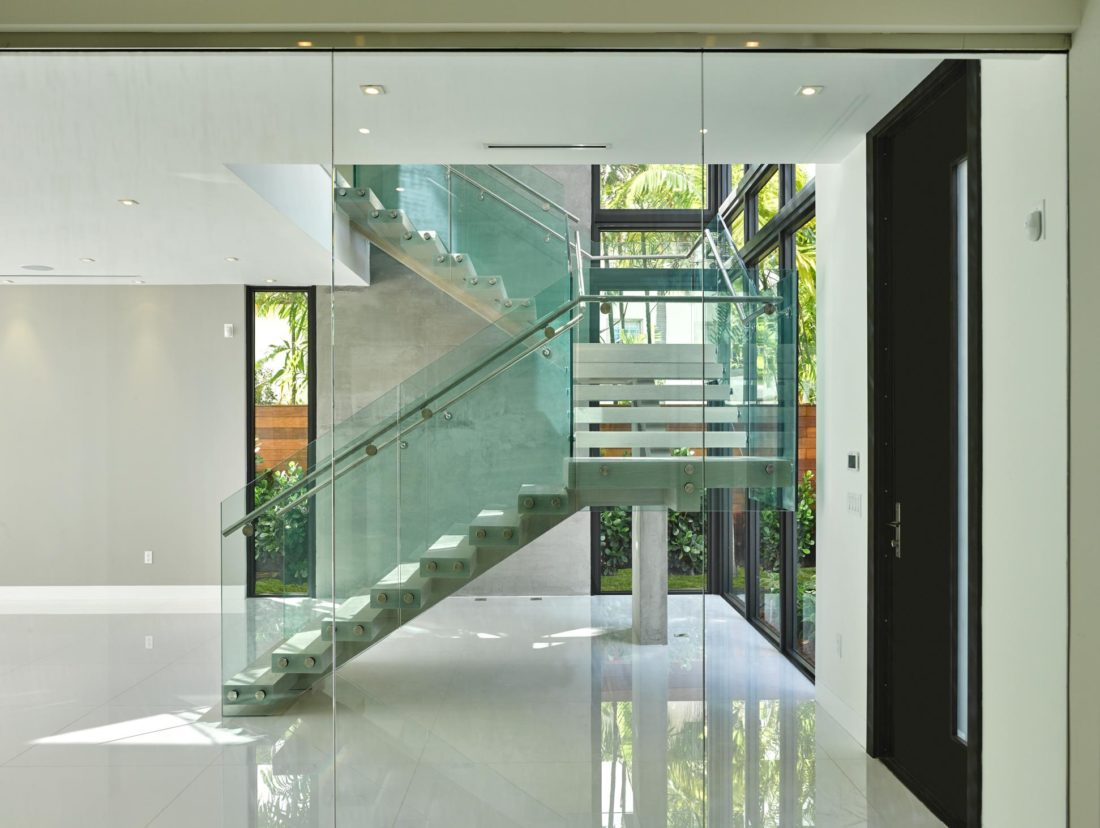 Glass railings give the staircase an open feel