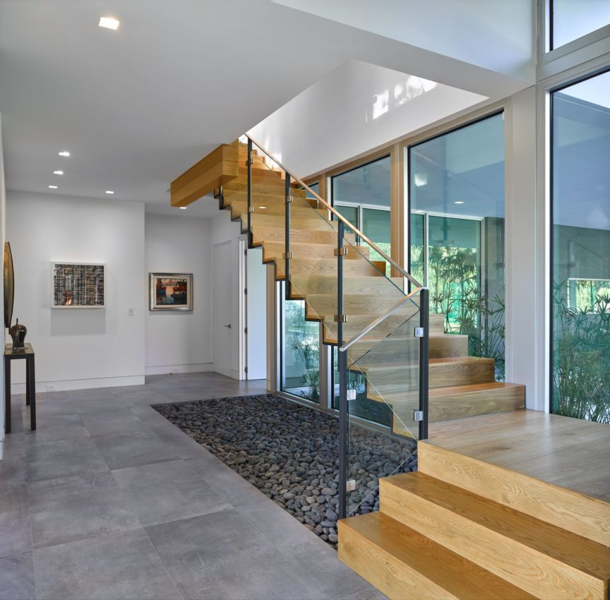 Open feel staircase with glass design