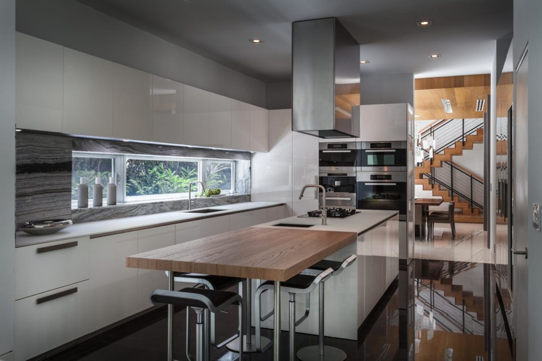 Kitchen featuring gourmet Boffi kitchen with white lacquer cabinets