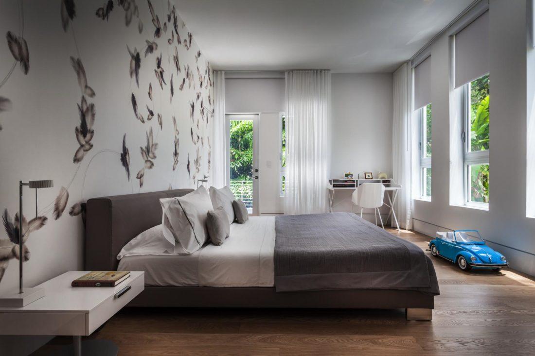 The bedrooms boast natural hardwood floors