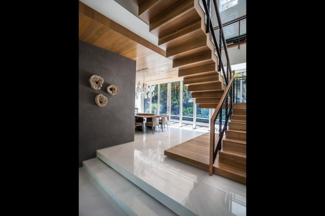 Wood staircase design adds to the open feel