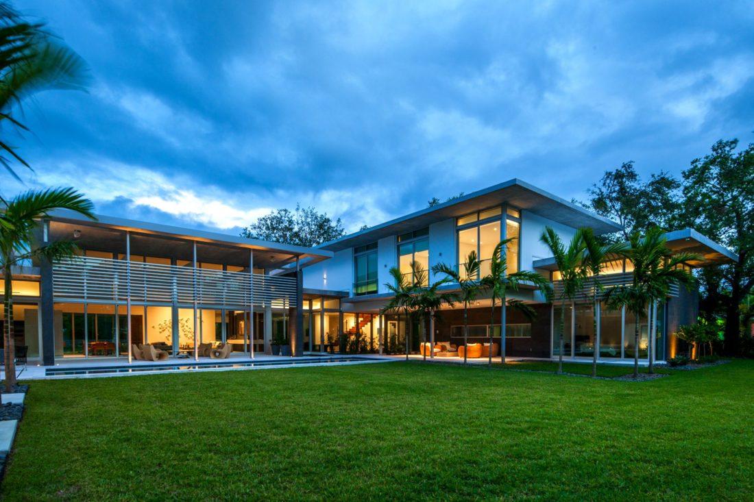 Large windows accentuate the backyard